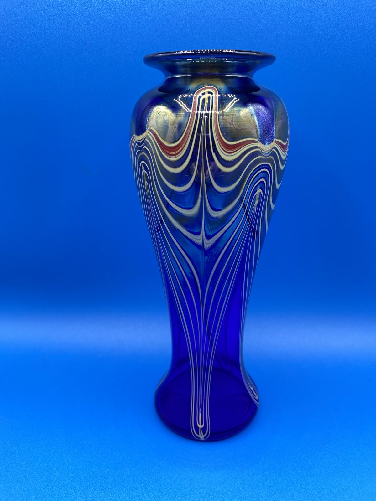 G1 - A hand-blown cobalt blue iridescent studio art glass vase by Marc Buotte, etched with his signature and dated 1998.  £175