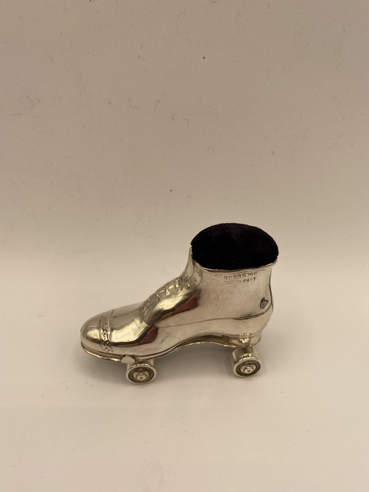 CAB 14 - A Rare Silver Roller Skate Pin Cushion, Hallmarked 1908.  £395
