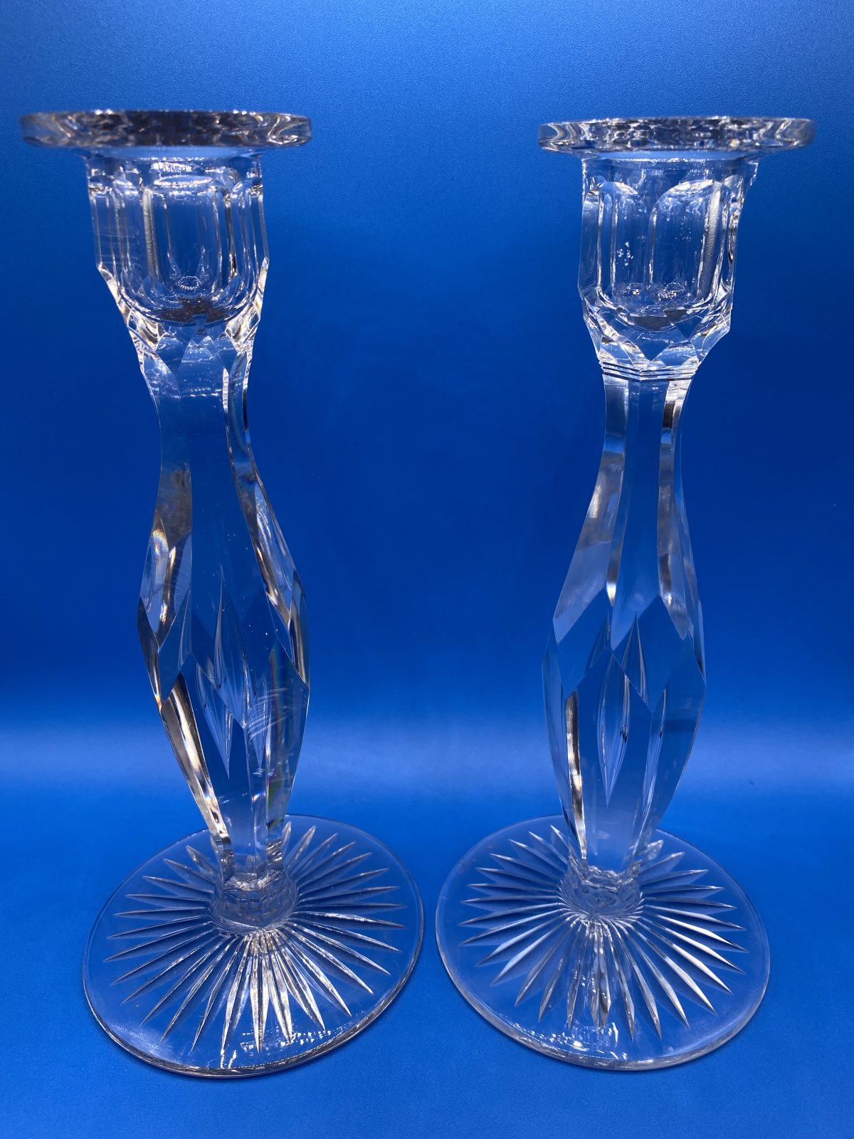 G1 - A Large Pair of Heavy Facet Cut Crystal Candlesticks with decorative air bubble in stem, on star cut bases. C 1950.  £95