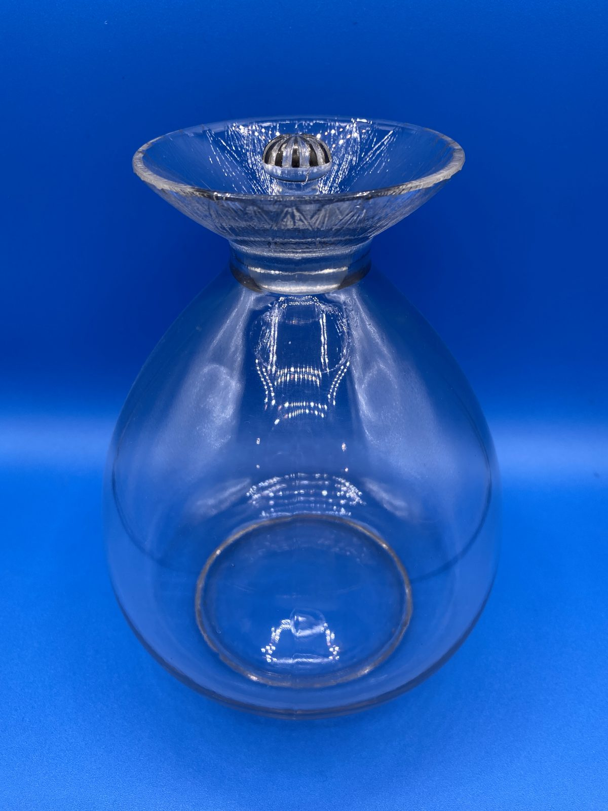 G1 - A Rene Lalique Port Decanter in the Lotus Pattern c1924, not made after 1947. Marcilhac page 830, no.5031. Fully signed and numbered to base, slight wear to enamel on stopper, otherwise perfect condition.  £495