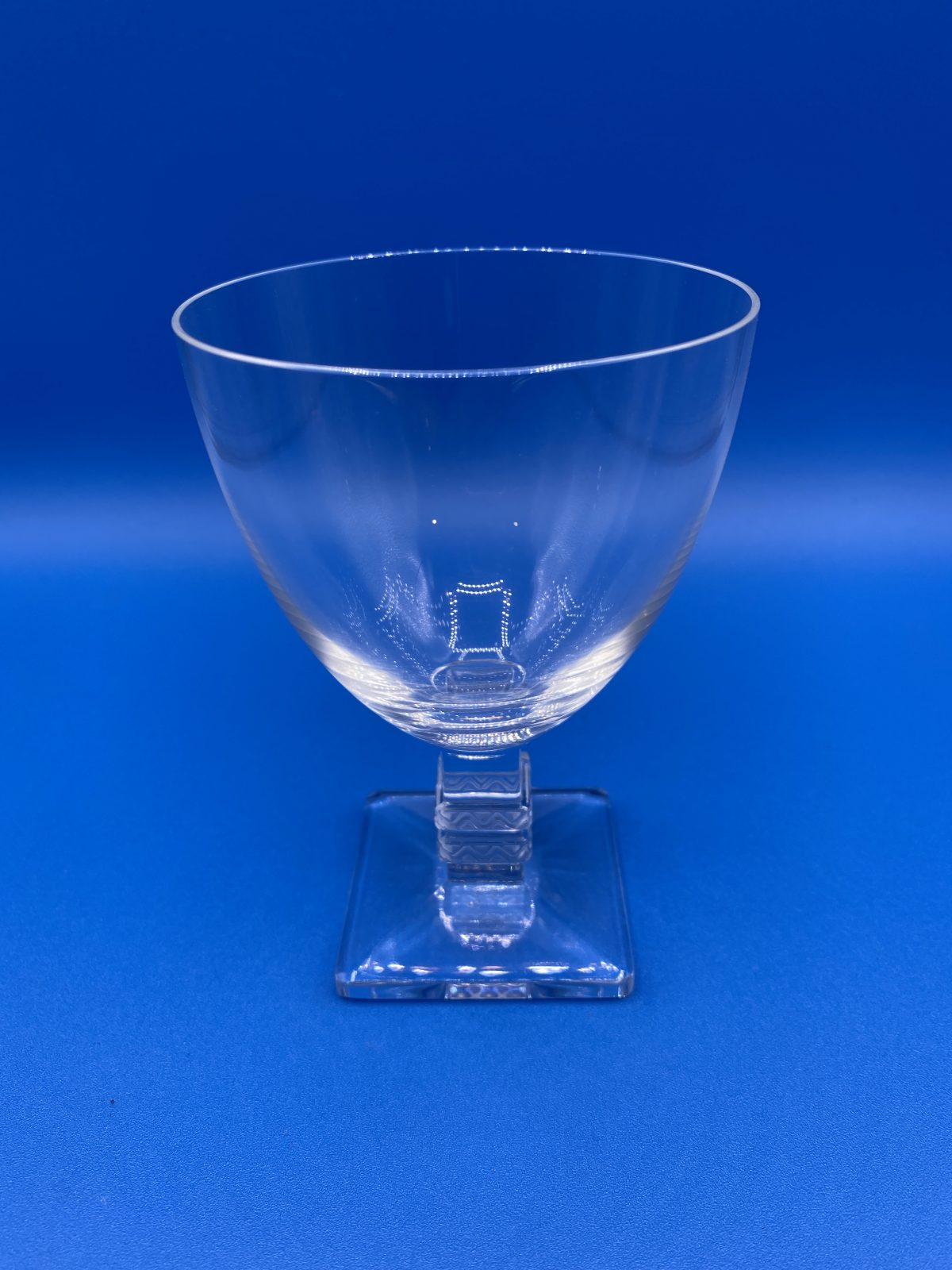 G1 - A Fine Set of 7 Lalique White Wine Glasses in the Argos Pattern, post war, all signed to base.  £725